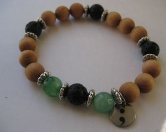 Semicolon my story isn't over yet bracelet with lava, sandalwood and green quartz beads