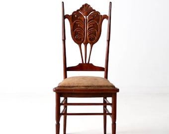 antique carved wooden accent chair, reeded leg upholstered chair