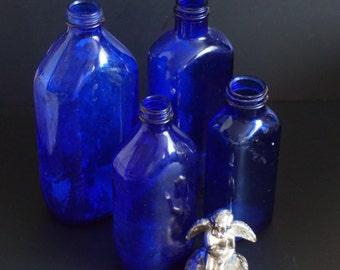 Vintage, Set of Four Cobalt Blue Glass Medicine Bottles