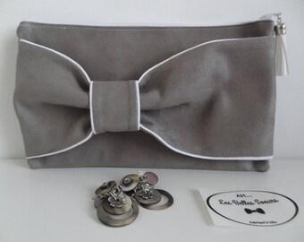Grey suede bow clutch