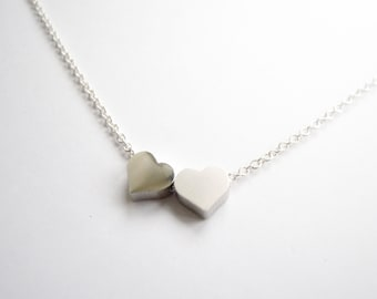 Silver necklace with two tiny hearts