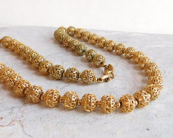 Vintage Signed Monet Goldtone Long Beaded Necklace - Ornate Openwork Cage Beads on Chain -  25 Inches - Faux Gold Beads - 1960s Mod Fashion