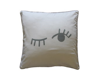 White and gray wink decorative pillow