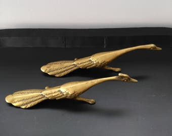 Vintage bronze couple goose and Gander in full flight. Vintage bronze goose and gander