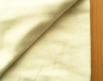 japanese fabric. solid cotton double gauze. 108cm (42.5in) wide. sold by 50cm (19in) long / half yard. pale yellow
