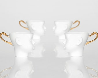 Doll head cups - set of four white porcelain and gold artisan cups,