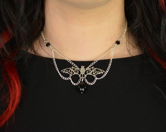 Bat necklace with black or red glass beads