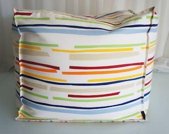 Soft pouf with colour stripes