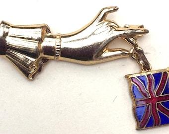 1940s Delicate Hand holding an Enamel Union Jack Brooch...