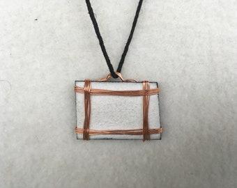 White Enameled Pendant on Black Cord Necklace
