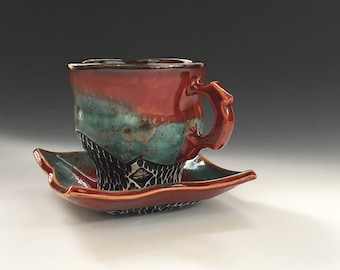 Porcelain Tea Cup and Saucer In Red and Blue Iron Spot Glaze, Hand Built Ceramic Cup For Tea Lovers. 3.75 in. tall, holds 10 oz. Food Safe.