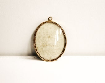 Antique gold picture brass frame with glass and a loop for hanging