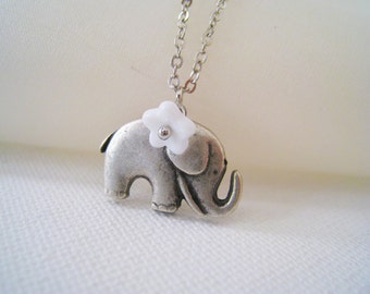 Lovely Elephant Necklace. elephant charm with white flower necklace
