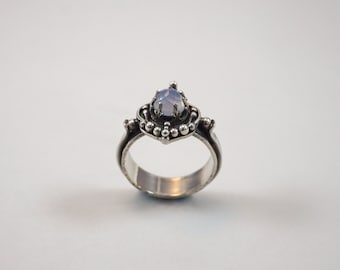 Chalcedony.  Sterling silver ring with rose cut chalcedony cabochon.  Size 6.75.  Handmade. One of a kind.  Pale blue.