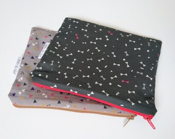Clutch purse with graphics little knots/triangles
