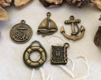 set of 5 bronze themed charms, buoy, Medal, boat, anchor, Board book