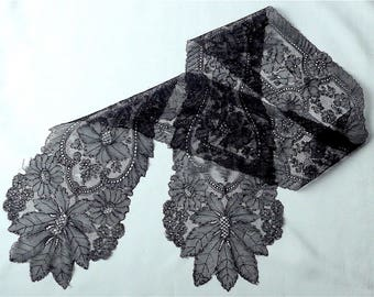 Chantilly bobbin lace lappet, antique.  A beautiful black lace lappet, as light as a feather with a lovely floral design. c1860's.