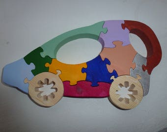 Handmade puzzle of solid wood , car