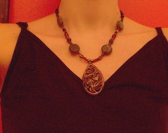 Wood fish necklace with tiger eye, and pyrite