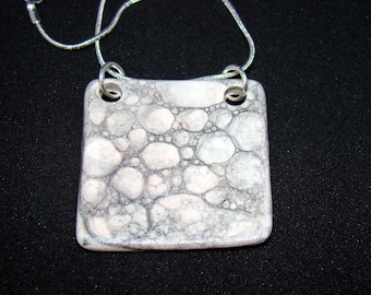 handmade ceramic and silver necklace, grey and white handmade bubbles pendant in Spain, handmade pendants