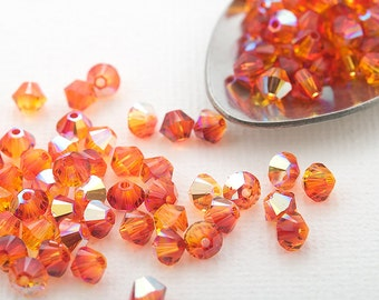 Swarovski crystal 4mm bicone beads small packaging 24 pc. fireopal AB Xilion 5328