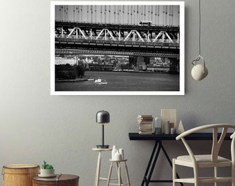 Black and White Photograph of the Manhattan Bridge in New York City wiht a Truck Above and a Boat Below for Download