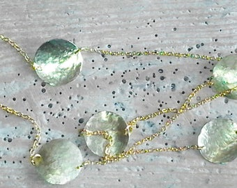 Long necklace with inserts in brass or hammered copper