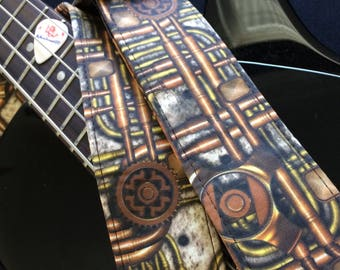 Steampunk guitar strap // retro-futuristic hydraulic pipes and gears weathered brass copper // unique music technology cyberpunk gamer gift
