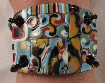 Multicolored collage polymer clay bracelet with glass beads