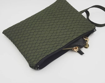 Green shell with wrist strap clutch.