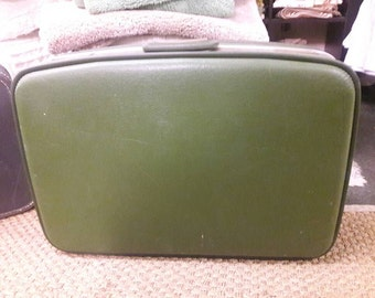 Vintage retro hipster luggage suitcase green