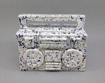 White ceramic boombox with sprankles, ghettoblaster, ceramic art, hiphop-style, ceramic sculpture