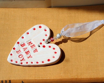 New Baby Boy Handmade Pottery Heart for a Baby Shower, sent to you in a lovely gossamer bag ready to give as a gift.