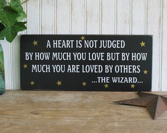 Wood Sign Wizard Of Oz A Heart is not Judged Wall Decor, Plaque Wizard Quote Wall Art Painted Black