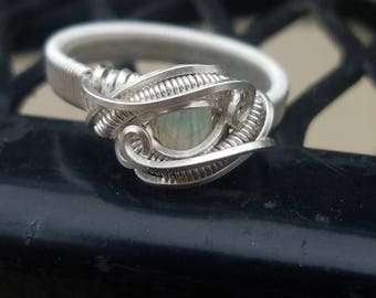 Opal and silver ring of any size.