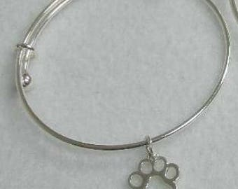 Bangle bracelet with open paw print charm