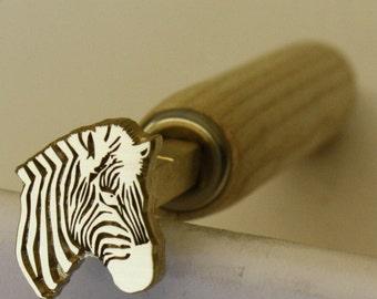 Bookbinding finishing tool (Zebra)