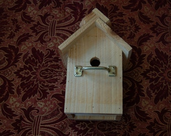 Cedar birdhouse with scalloped roof and unique perch