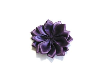 Flower in plum colored satin fabric