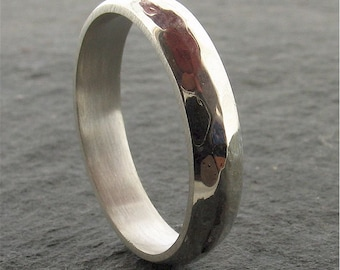 Hammered silver wedding ring 4mm wide Pebble design for a woman or a mans wedding band