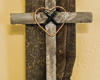 Metal cross with copper heart