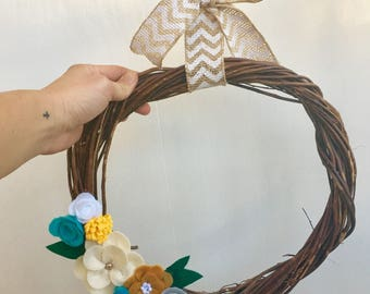 grapevine wreath with felt flowers