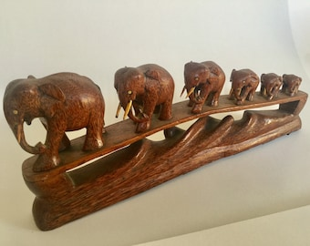 Vintage wooden Family of 6 Elephants crossing a bridge