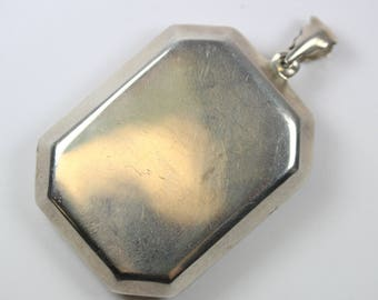 A Large Sterling Silver Long Otagon Shaped Locket