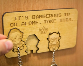 """Legend of Zelda """"It's dangerous to go alone!"""" Lasercut & Engraved keyring and wall mount"""