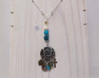 Essential Oil Diffuser Necklace of Silver Medallion of Charms with Turquoise and a Lava Rock