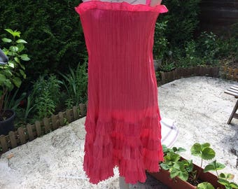 Strawberry silk pleated ruffle dress and closing a zipper at the back for cocktail or evening dress women