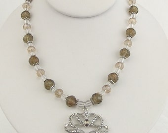 light browns, clear and silver necklace with pendant