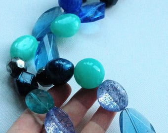 Necklace - Chunky blue and turquoise blue and clear plastic necklace with glitter inclusion