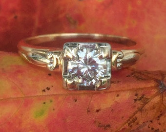 1940's illusion setting half carat diamond ring